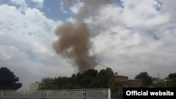 Smoke rises from the Afghan parliament building in Kabul on June 22.