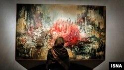 یکی از آثار ایران درودی بر دیوار نمایشگاهی در تهران
