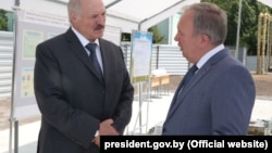 "President Alyaksandr Lukashenka (left) speaks with former Deputy Prime Minister Vasil Zharko in June 2016. ""I had warned him three times: Look around, sort things out,"" Lukashenka says. ""And things collapsed there. How can I work with such a person?"""