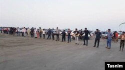 Residents for a human chain in Iran's Qeshm island to protest decision handing over tourism services to private sector. October 21, 2019