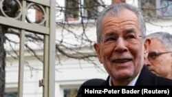 Alexander Van der Bellen, who is supported by the Greens, leaves a polling station in Vienna on December 4.