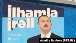 An election campaign poster for Azerbaijani President Ilham Aliyev who is expected to easily win a new term of office later this month.