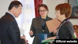 U.S. Ambassador Susan Elliot (right) meets with Tajik Interior Minister Ramazon Rahimov on April 14.