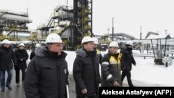 Russian Prime Minister Dmitry Medvedev (center) and Rosneft chief Igor Sechin (front left) inspect production facilities in Sibera on on November 21.