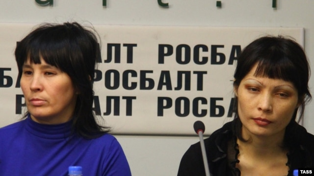 Bakiya Kasymova (left) and Leila Ashirova, both recently freed from what they describe as captivity, talk to reporters in Moscow on November 2.