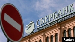 "The new sanctions will limit the operational ability of major Russian banks, including Sberbank (pictured) and VTB Bank, according to ""The Wall Street Journal."""