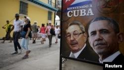 Президенти Куби Рауль Кастро і США Барак Обама на плакаті у Гавані