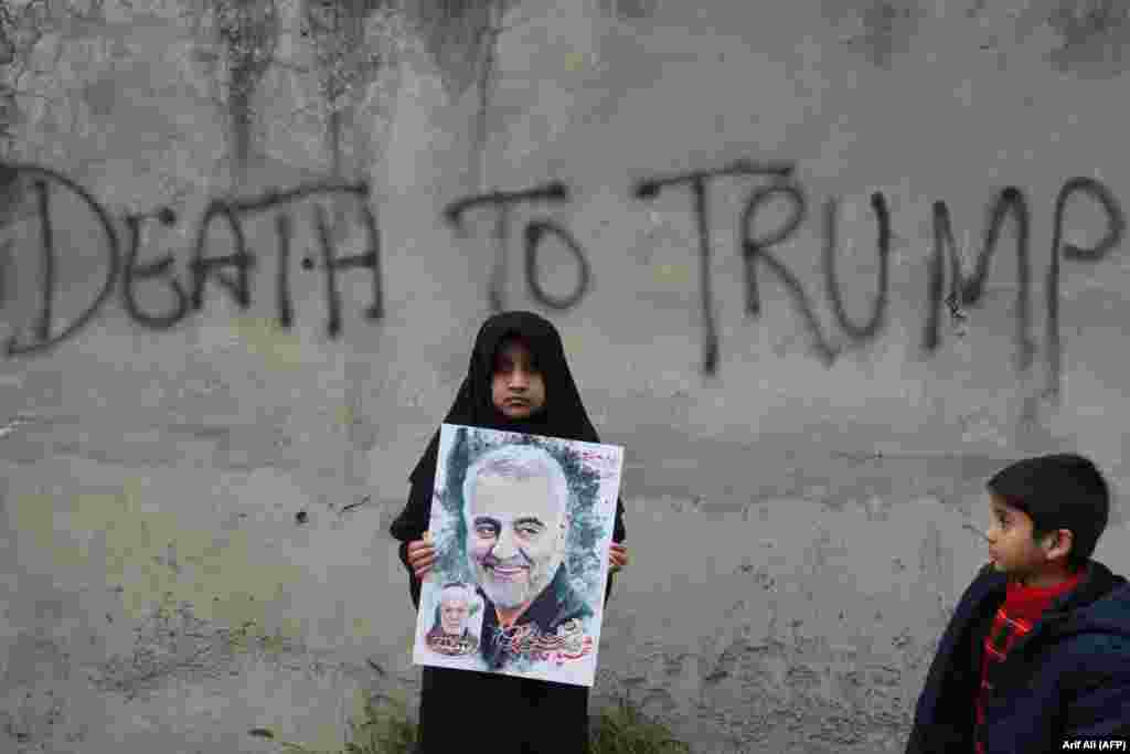 A Shi'ite Muslim girl holds a poster of Iranian commander Qasem Soleimani as she takes part in an anti-U.S. protest in Lahore, Pakistan, against his assassination in Iraq by a U.S. drone on January 3. (AFP/Arif Ali)
