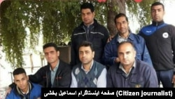 Iran - Haft Tapeh - Esmail Bakhshi (sitting C)after his release from prison among friends and coworkers. File photo