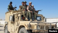 Afghan security forces arrive to fight off Taliban forces in the southern Helmand Province on October 21.