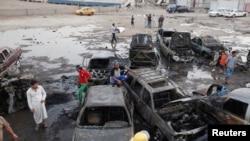 На месте одного из взрывов в Багдаде, 27 мая 2013 г.