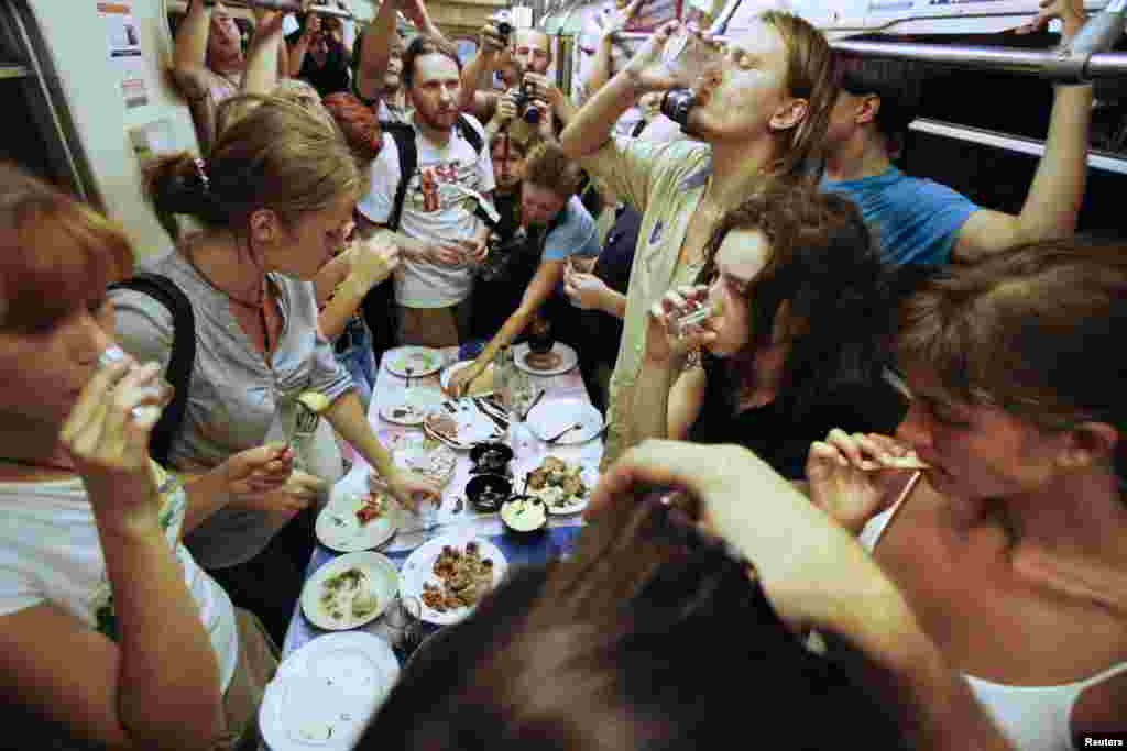 Nadezhda Tolokonnikova (bottom right) and fellow activists celebrate a wake for conceptual artist Dmitry Prigov in a Moscow metro carriage in August 2007. Tolokonnikova later became a member of Pussy Riot.