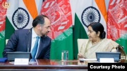 Afghan Foreign Minister Salahuddin Rabbani (L) with his Indian counterpart Sushma Swaraj in New Delhi.