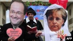 Aktivistët në Berlin bëjnë shfaqje me maska të presidentit francez dhe kancelares gjermane