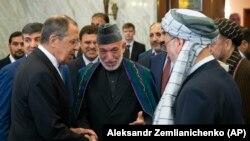 د روسیې بهرنیو چارو وزیر سرګې لاوروف په مسکو کې د افغانستان له پخواني ولسمشر حامد کرزي سره د خبرو پر مهال. ۲۰۱۹ز کال ۲۸م مې