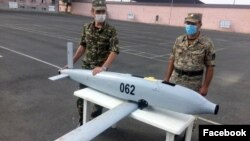 "Armenia -- Armenian officers demonstrate an Israeli-made ""suicide"" drone SkyStriker which they say was intercepted during fighting with Azerbaijani forces, July 24, 2020."