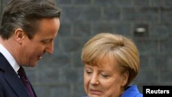 British Prime Minister David Cameron and German Chancellor Angela Merkel have been criticized for allowing economic issues to keep them from punishing Russia for its intervention in Crimea.