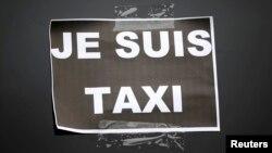 Один из плакатов бастующих таксистов