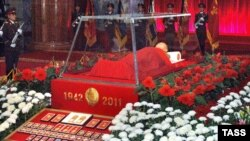 The coffin with the body of North Korea's late ruler, Kim Jong Il, is laid out in a glass sarcophagus in a room of the Kumsusan Memorial Palace during a ceremony on December 21.