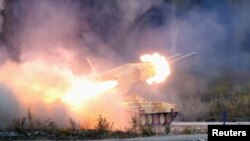 "Russia -- A ""TOS-1 Buratino"" multiple rocket launcher fires during the ""Russia Arms Expo 2013"" 9th international exhibition of arms, military equipment and ammunition, in the Urals city of Nizhny Tagil, September 25, 2013"