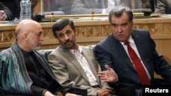 Iranian President Mahmud Ahmadinejad (center), his Afghan counterpart, Hamid Karzai (left), and Tajik President Emomali Rahmon talk during a trilateral regional summit in Tehran.