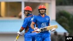 Afghan crickers Mohammad Nabi and Gulbadin Naib (R) during a recent match of Afghanistan 50 runs partnership during the 1st ODI cricket