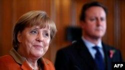 "German Chancellor Angela Merkel (left) said national positions were ""still quite apart."""