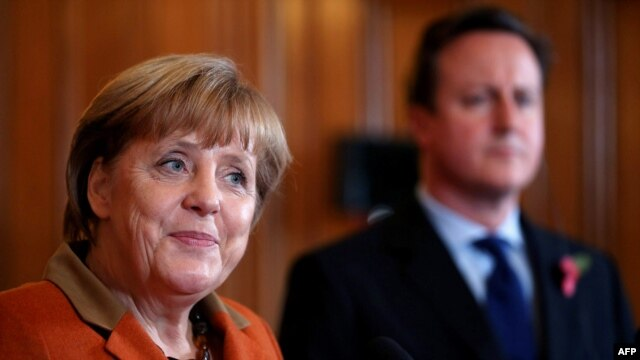 "German Chancellor Angela Merkel (left) said national positions were ""still quite apart."""