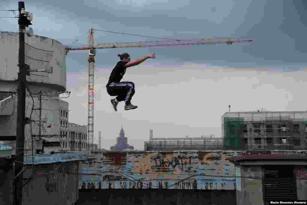 Vad Him jumps on a rooftop in Moscow.