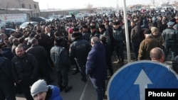 Armenia - Angry residents of Echmiadzin block a highway in protest against a Yerevan court's decision to release retired General Manvel Grigorian from pretrial detention, January 12, 2019.