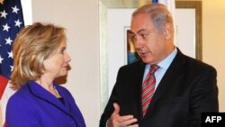 U.S. Secretary of State Hillary Clinton with Israel's Prime Minister Binyamin Netanyahu before their meeting in New York on November 11.