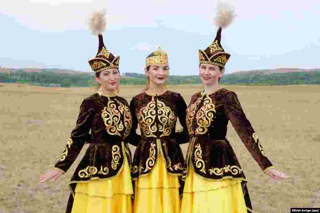 Women pose in traditional Kazakh dress during the fifth leg of the Silk Way Rally 2017 from Astana to Semey in Kazakhstan on July 12. (epa/Olivier Anrigo)