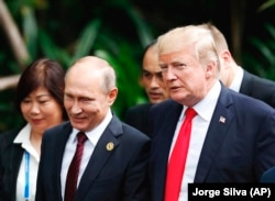 U.S. President Donald Trump (right) and Russian President Vladimir Putin talk on the sidelines of the APEC summit in November in Vietnam.
