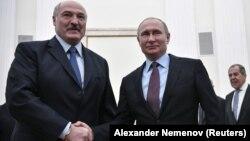 Аляксандар Лукашэнка і Ўладзімір Пуцін 25 сьнежня 2018 году ў Крамлі.