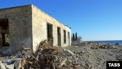 Partly demolished buildings stand on Sochi's waterfront, where new construction is set to begin.