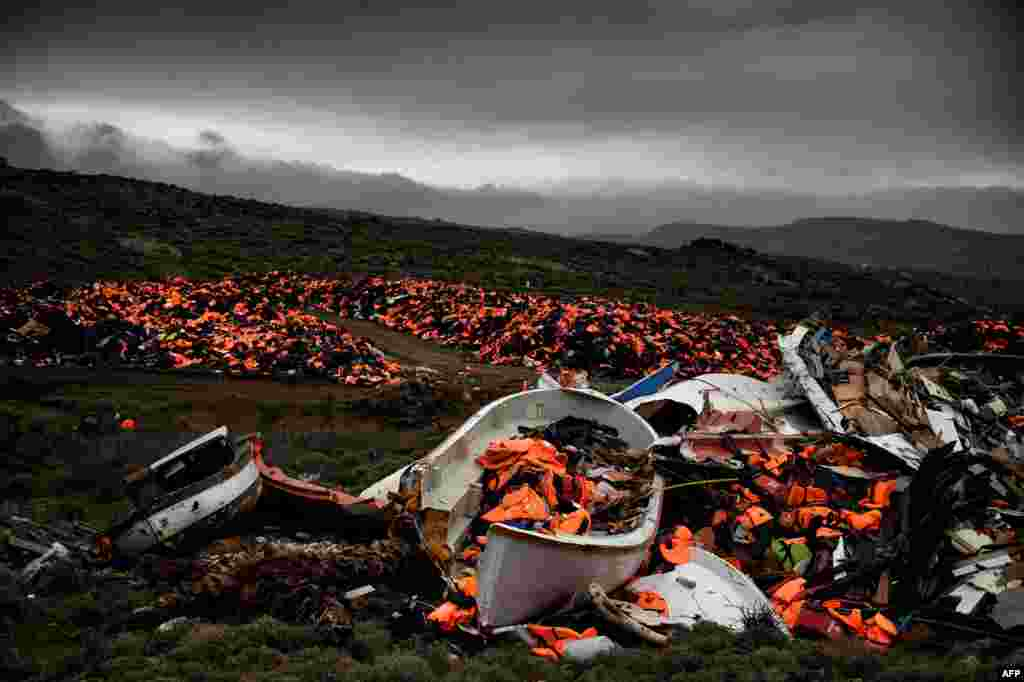 Wrecked boats and thousands of life jackets used by refugees and migrants during their journey across the Aegean Sea lie in a dump in Mithimna, Greece. (AFP/Aris Messinis)