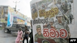 A man reads a newspaper bearing a photo of Tamil Tiger leader Velupillai Prabhakaran on the front page in Colombo on May 18.