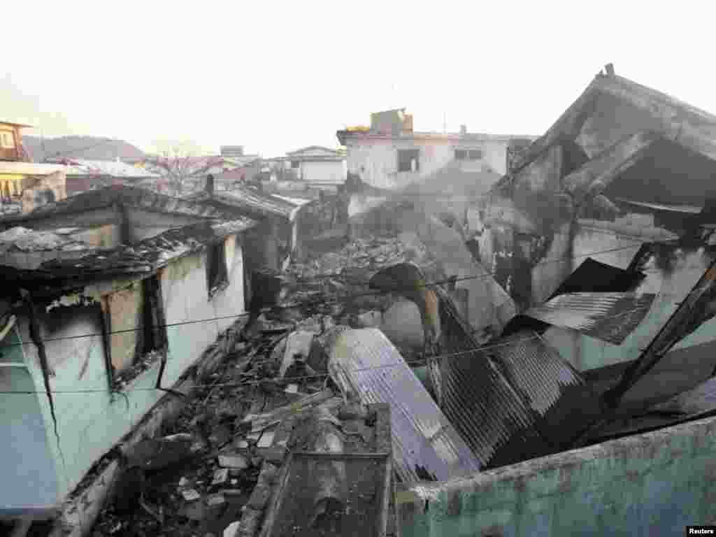 Будівлі, зруйновані унаслідок артилерійського удару. У світі різко засудили обстріл південнокорейської території армією КНДР. Південна Корея, 23 листопада. Photo by REUTERS