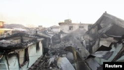 Houses destroyed after being hit by artillery shells fired by North Korea on Yeonpyeong Island