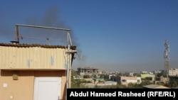 Дым над кварталом в Кабуле, в котором произошел смертоносный взрыв. 24 июля 2017 года.