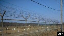 Ограждение на границе Северной Кореи и Южной Кореи.