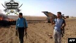 تکهای از جنگنده میگ ۲۱ که گفته میشود به دست شورشیان در استان ادلب سرنگون شده است. تصویر مربوط به ویدیویی است که روز سهشنبه چهارم سپتامبر بر روی اینترنت قرار گرفته است