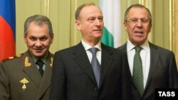 Russia -- (L-R) Defense Minister Sergei Shoigu, Nikolai Patrushev, chairman of the Security Council, and Foreign Minister Sergei Lavrov attend a meeting in Moscow, December 22, 2014