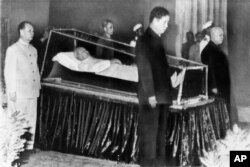 North Vietnamese leaders stand around the body of President Ho Chi Minh on September 7, 1969.