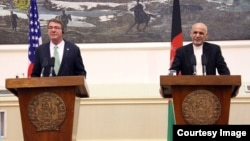 U.S. Defense Secretary Ash Carter (left) made his remarks at a press conference with Afghan President Ashraf Ghani (right) during a previously unannounced visit to Afghanistan.