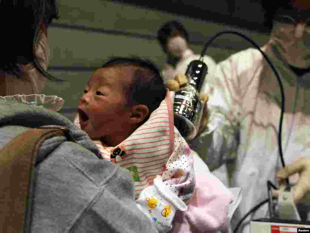 A baby born on March 15 is tested on March 31 for possible nuclear radiation at an evacuation center in Koriayama in northern Japan, about 70 kilometers from the tsunami- and earthquake-crippled Fukushima nuclear power plant. Photo by Kim Kyung-hoon for Reuters