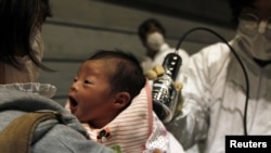 A baby who was born on March 15 is tested for possible nuclear radiation at an evacuation center in Koriayama, Japan, on March 31.