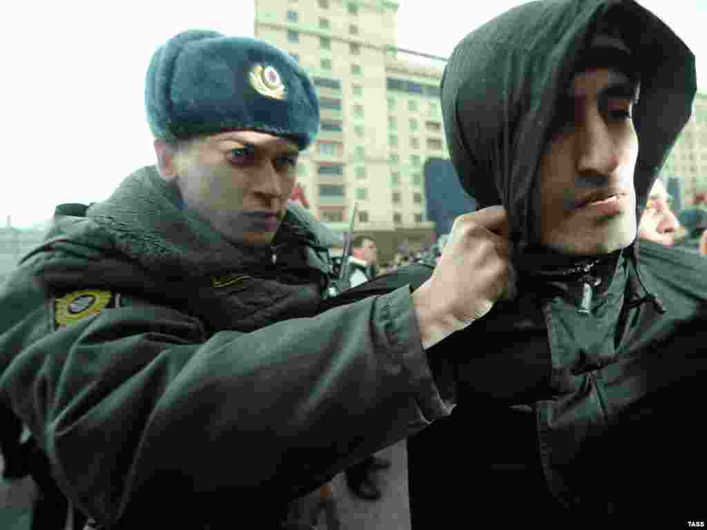 A Russian policeman detains a demonstrator after an authorized Day of Wrath protest in central Moscow on April 10. Photo by Vladimir Astapkovich for ITAR-TASS