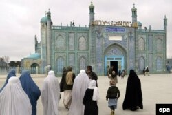 Women enter the Blue Mosque of Mazar-e Sharif in north Afghanistan.