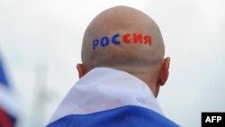 """Полша - Оьрсий ву коьрта тIе """"Оьрсийчоь"""" аьлла, йоза а яздина, Варшаверчу стадионехь футболе хьожуш, 12Манг2012"""